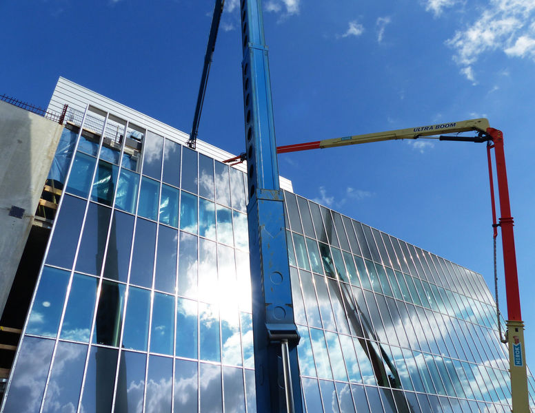 Target entrance building glass facades with steel cladding ongoing on high bay level